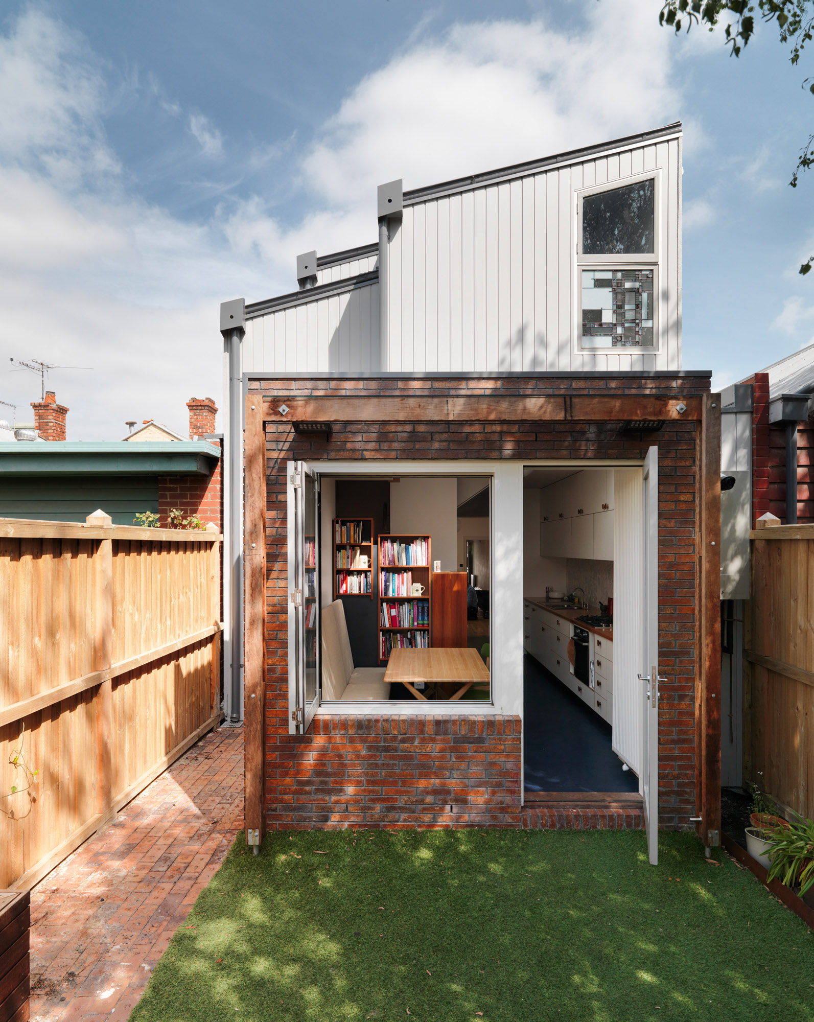 Live small terrace House extension, brick and timber cladding.