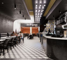 Black and white tiles burger restaurant interior
