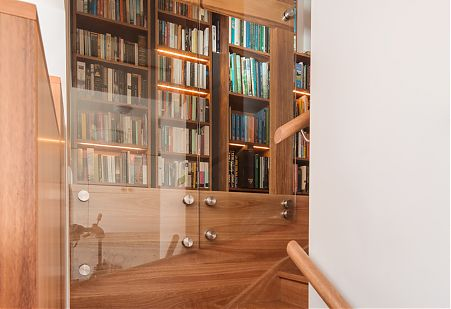 Tower of books bookcases and timber stair.