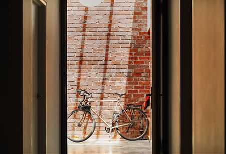View to light filled brick atrium with bicycle