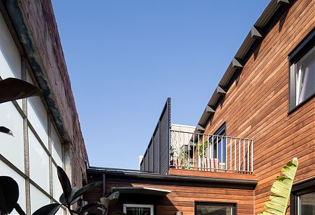 Timber cladding, warehouse courtyard and balcony.