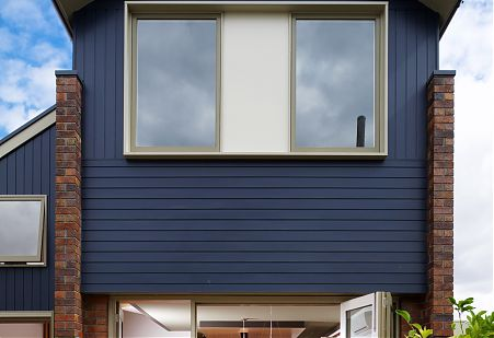Blue timber clad house exterior