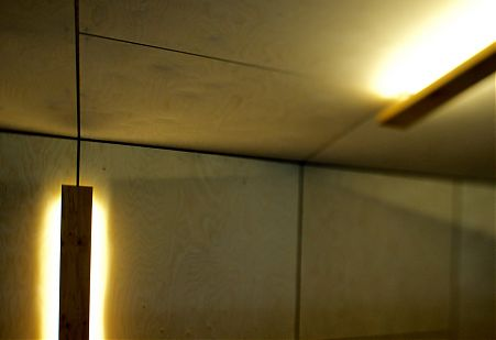 Plywood ceiling and wall panels with lighting.