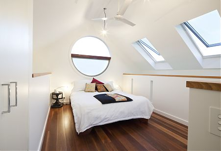 Loft bedroom round window
