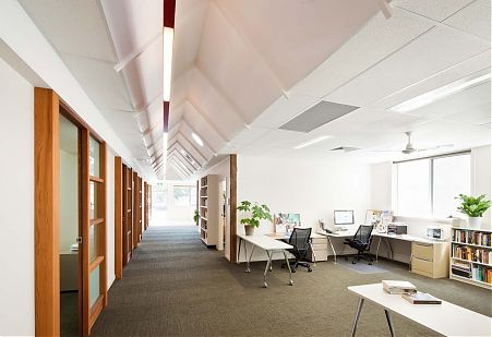 Pitched internal ceiling corridor office space