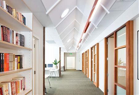 Light-filled interior pitched ceiling corridor
