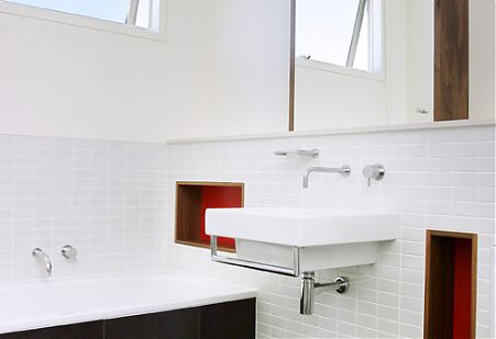 Minimalist bathroom white tiles timber red accent